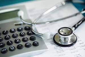 35905418 - calculator and stethoscope on financial statement concept for finance health check or cost of healthcare