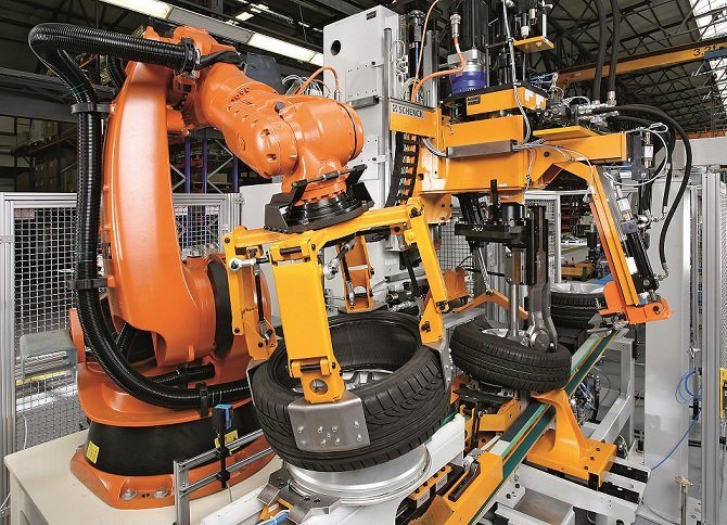 "Schenck's new fully automated tire assembly line features three technological highlights: the VENTUO inflation system, a fully-automated unbalance correction (top) and a robot-based ""marrying"" of tires and rims."